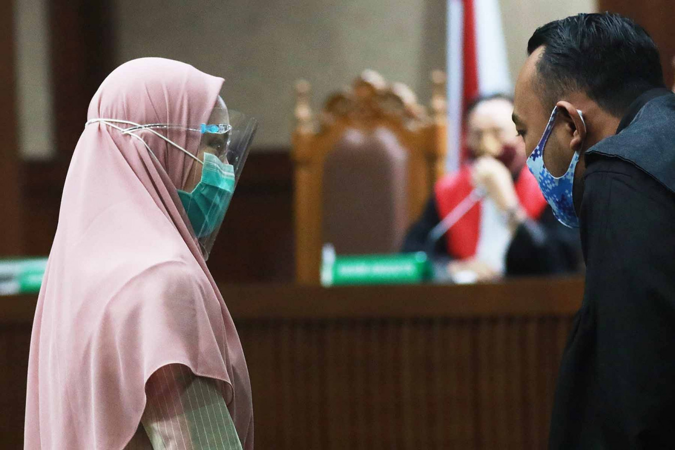 Pinangki Sirna Malasari has a conversation after a hearing in the Jakarta Corruption Court on Sept. 23. Prosecutor Pinangki is accused of accepting bribes amounting to US$500,000 from graft convict Djoko Soegiarto Tjandra for conspiring to secure an acquittal for him from the Supreme Court. JP/Dhoni Setiawan