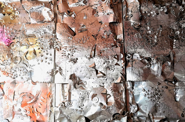 Experiment: Nyoman Erawan's most recent work is a triptych of aluminum panels carved with various tools, including a crowbar.