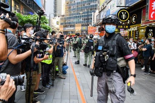 China jails 10 Hong Kong democracy activists for up to three years