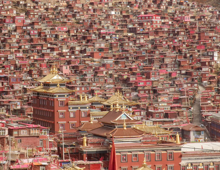 Hub for the holy: The Larung Gar Monastery is the world's largest monastery, home to thousands of monks and nuns, as well as the largest slum in the region.