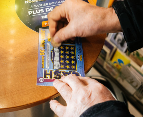 Beggars hit French jackpot with gifted scratchcard