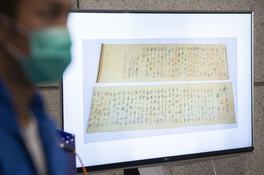 Stolen $300 million Mao scroll found 'cut in half': Hong Kong police