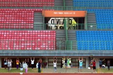 COVID-19 patients undergoing isolation at the Patriot Candrabhaga Stadium in Bekasi, West Java, participate in morning exercises on October. 2. 2020. Physical exercise is deemed important to increase patients' immunity while undergoing isolation. JP/Dhoni Setiawan