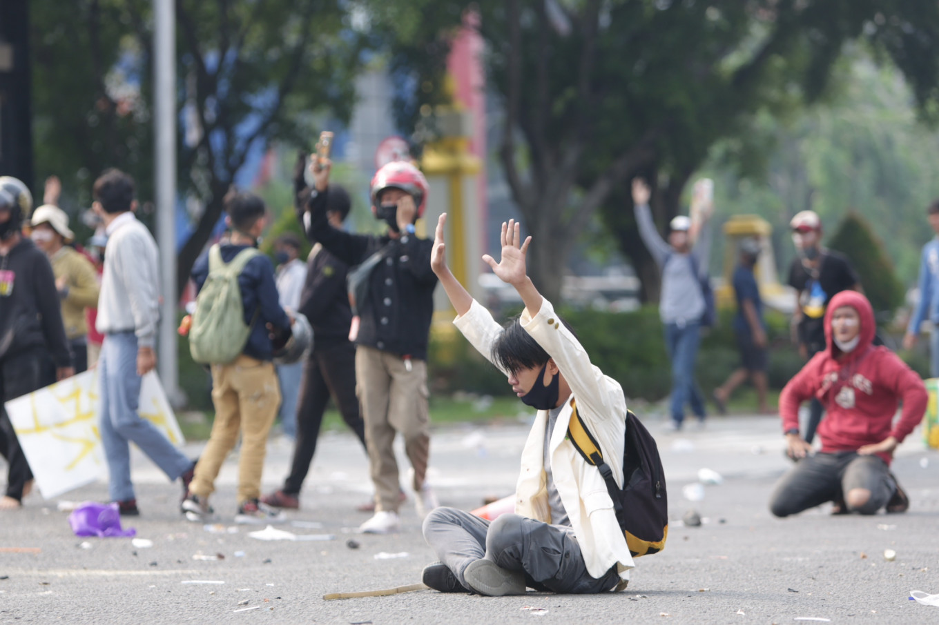 No violence: A protester holds up his arms while sitting in a road during a protest on Thursday, october 8. 2020 in Harmoni, Central Jakarta. The demonstration in the historic district descended into violence as a clash broke out between protesters and the police. JP/Wendra Ajistyatama