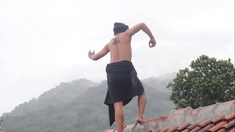 Dancer on the roof: Dancer Erri Trihartono explores movements atop a roof in