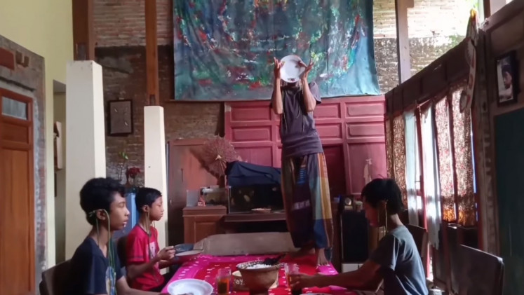 Creativity in isolation: Mugiyono performs on a table in