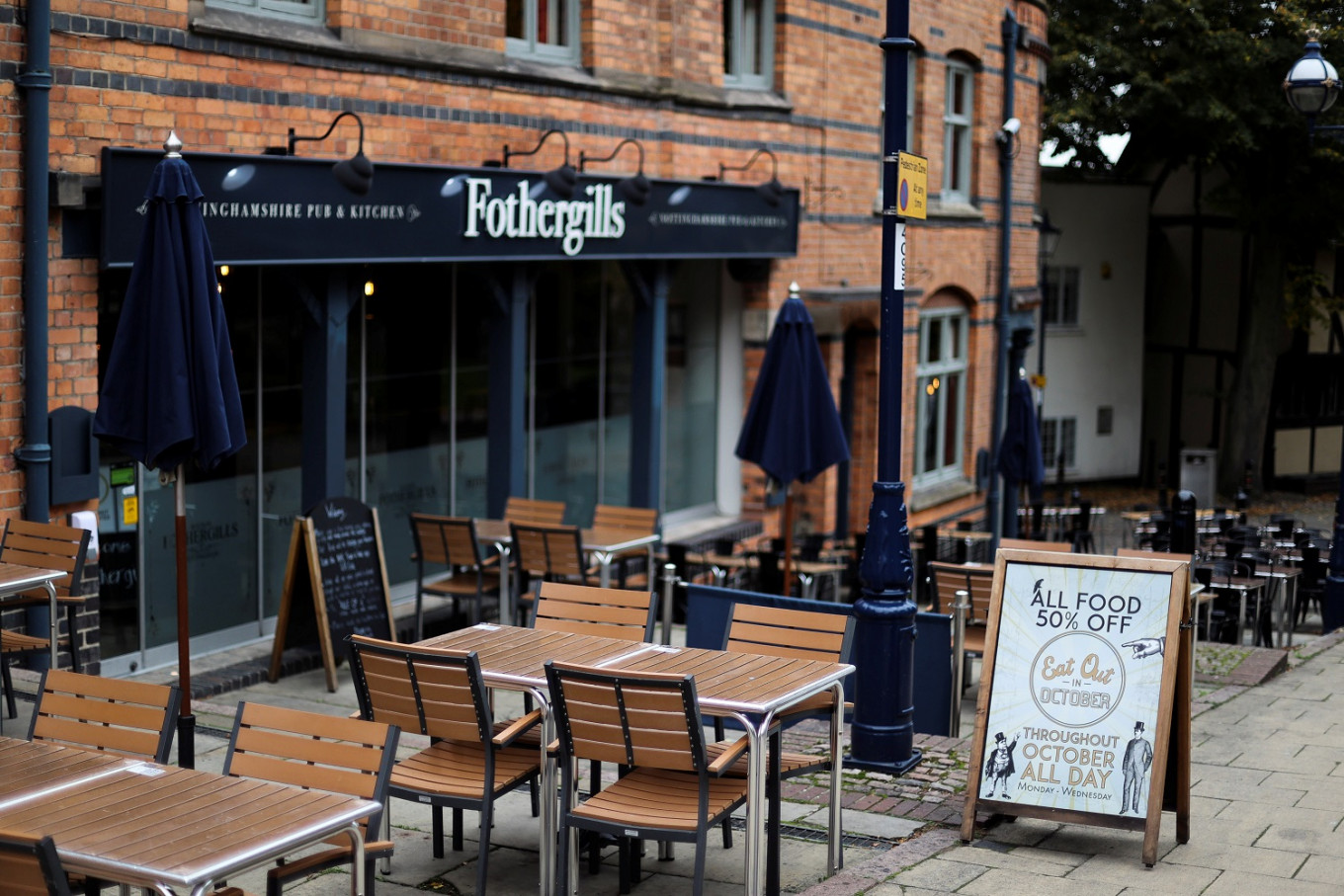 England's pubs ponder if pasties or chips make a meal amid COVID lockdown