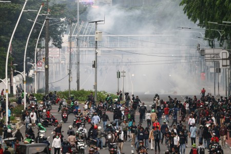 Hundreds arrested in Jakarta as clashes break out in protests against jobs law