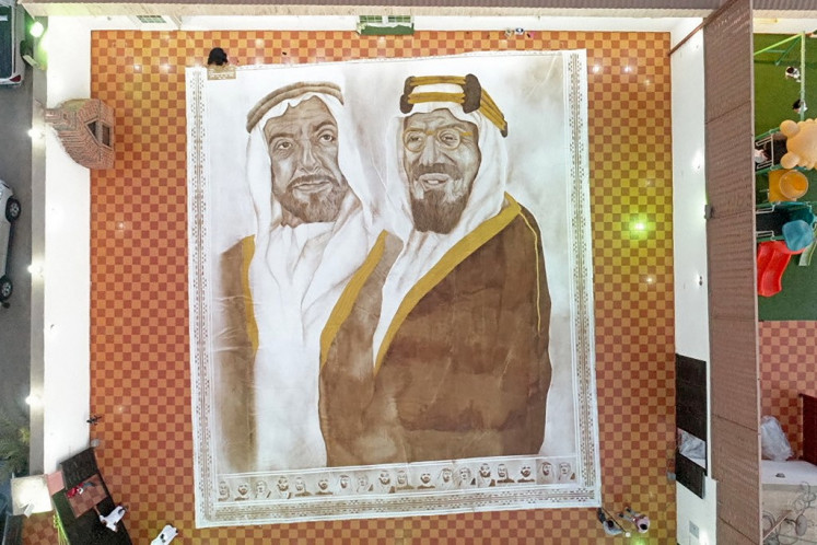 Saudi woman makes world's 'largest coffee painting'