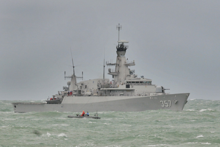 The British-made KRI Bung Tomo 357 multirole light frigate is on station in the Karimata Strait on Dec. 31, 2014, as it assists in the search for the missing AirAsia flight QZ8501.