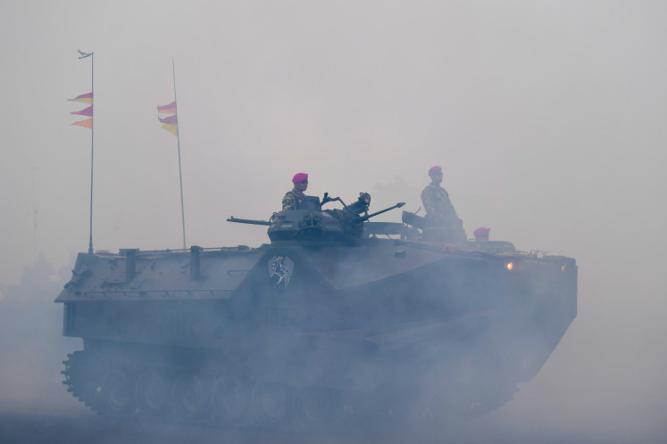 Marine Corps personnel of the Indonesian Navy observe the field from their LVTP-7A1 armored vehicle during a training exercise on Feb. 18, 2020.