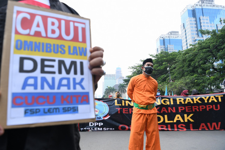 Workers, students return to street for new jobs law protest