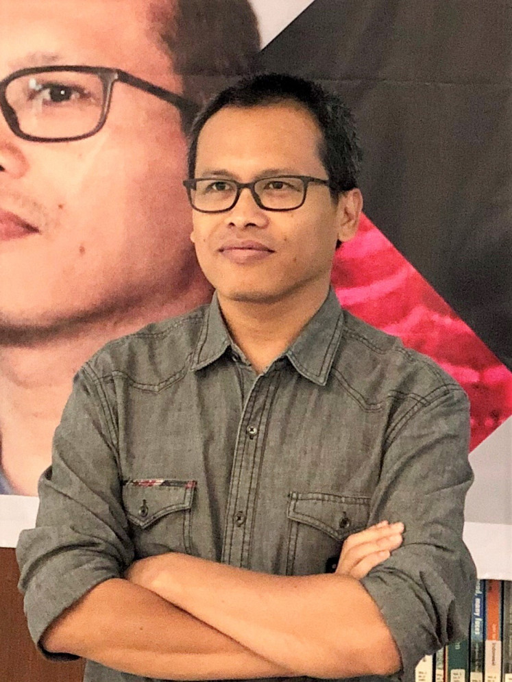 The author: Indonesian author Eka Kurniawan poses on the sidelines of the Prince Claus Award ceremony in February 2019 at the Erasmus Huis Dutch cultural center in Jakarta.
