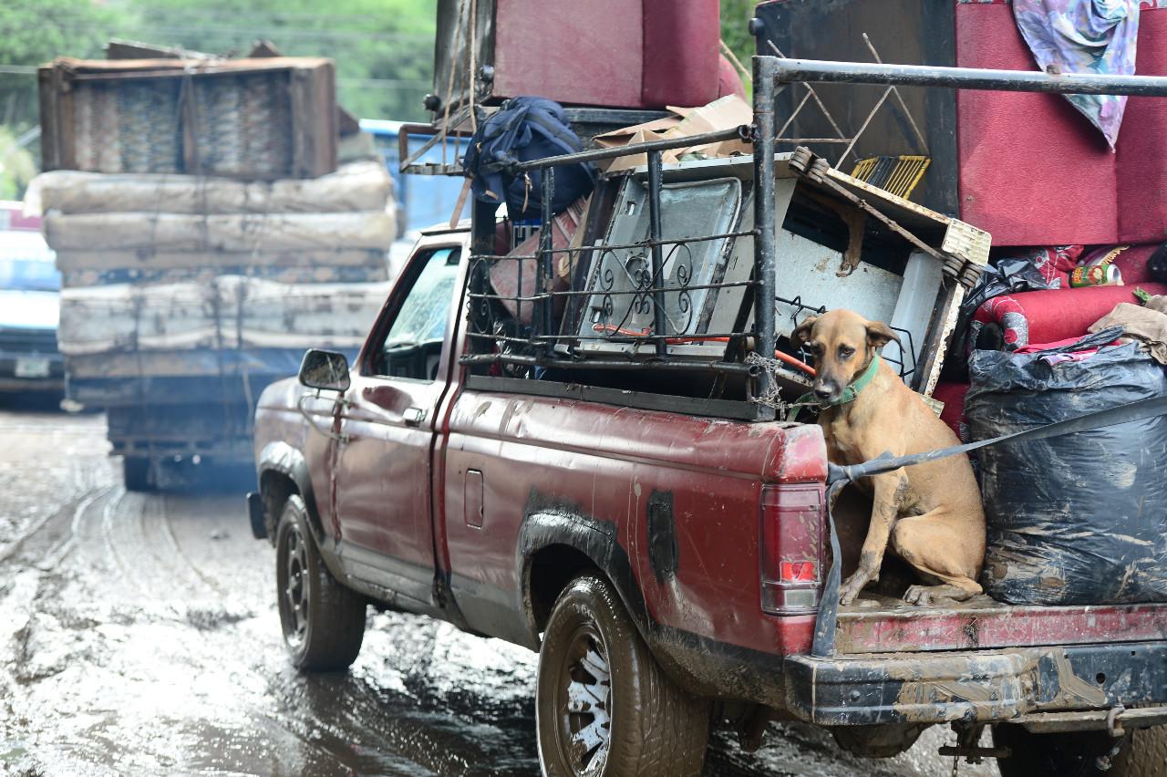 Rescuers struggle to reach storm-hit Guatemalan village; dozens missing