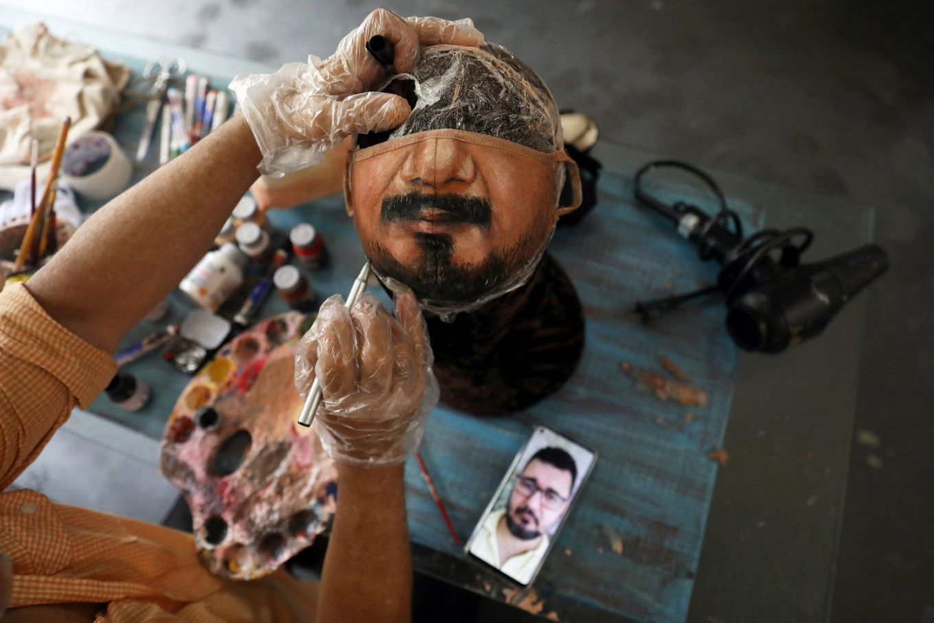 Brazil artist paints masks for those who want to show their face