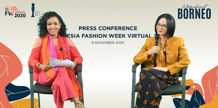 All smiles: Fashion designer and IFW president Poppy Dharsono (right) believes that fashion can be used as a tool for diplomacy.