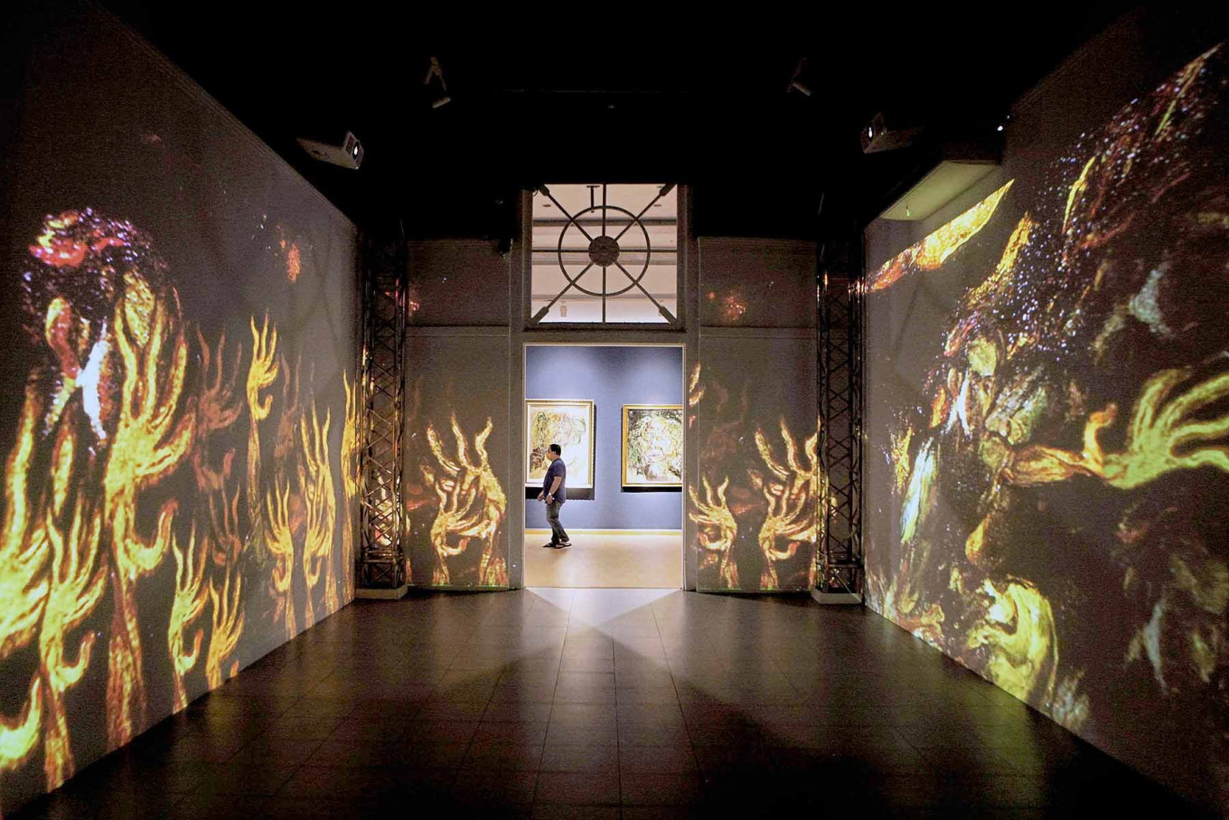 """Visitors look at a video display on Nov. 1, 2020 during the """"Immersive Affandi: Human, Space, Nature"""" exhibition, which runs from Oct. 26 to Nov. 25 at the National Gallery of Indonesia in Jakarta. JP/Seto Wardhana"""