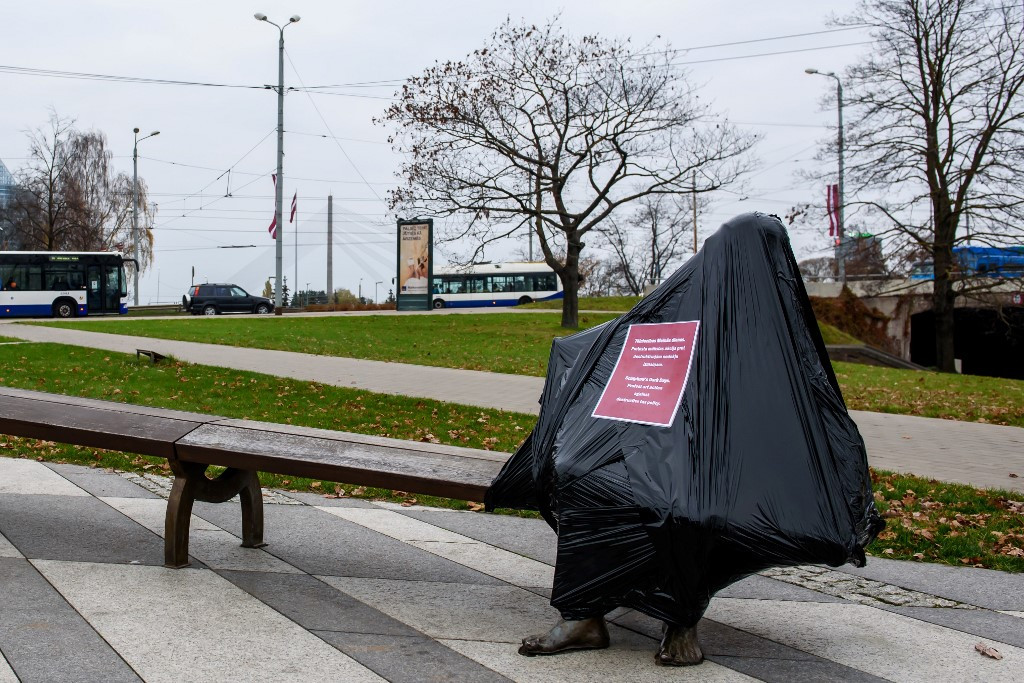 Latvian sculptors cover up statues to protest tax hike