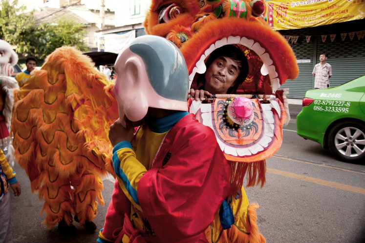Street performance: The Sino-Thais are the majority population of Bangkok. But as society changed, Chinese opera and lion dances started to be performed by a later group of indigenous migrants from Thailand's northeast region.