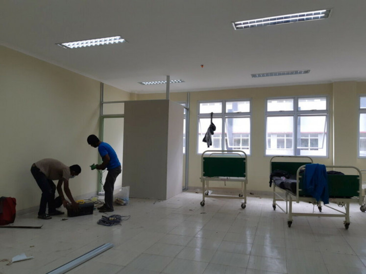 Workers prepare a building in the University of Lampung hospital with supporting facilities, such as beds and toilets, that is set to be an isolation facility for COVID-19 patients in Bandar Lampung, Lampung on Nov. 13.
