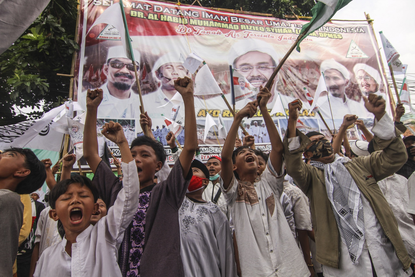 Jakarta military commander says he ordered removal of banners depicting Rizieq Shihab