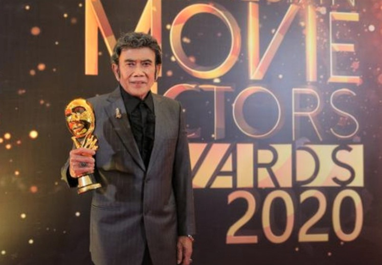 Living legend: Musician, actor and politician Rhoma Irama receives an award at the 2020 Indonesian Movie Actors Awards on July 25 for his dedication to the industry.