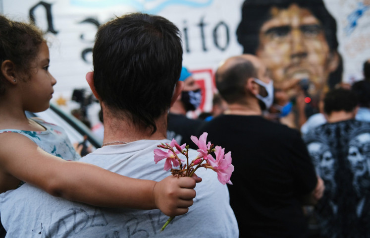 Indonesian fans join soccer world in mourning Maradona