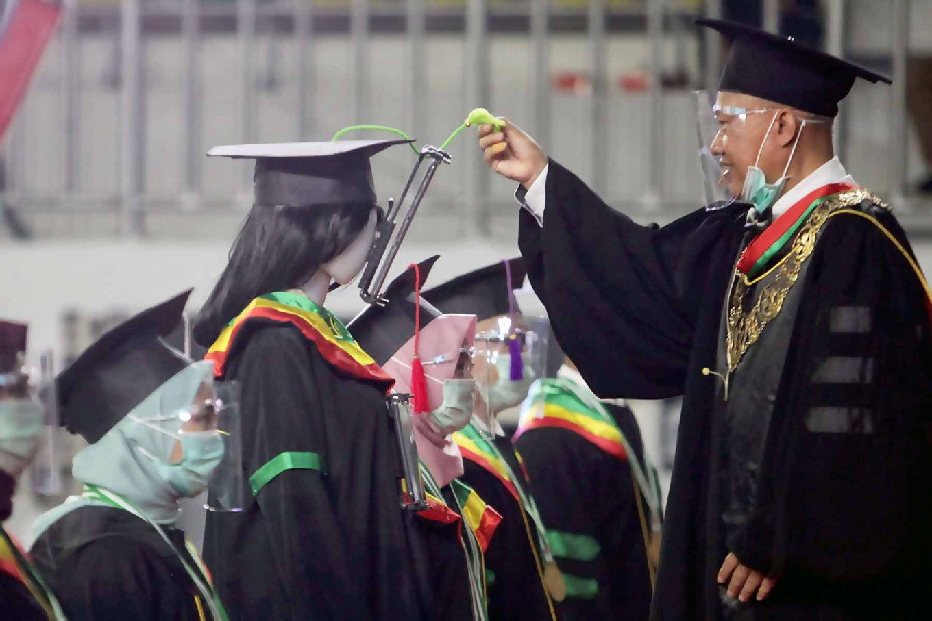 A Jakarta State University (UNJ) rector interacts virtually with a graduate during a graduation ceremony in Jakarta on Nov. 21. The ceremony celebrated 2,946 graduates and used technology to replace physical attendance amid the COVID-19 pandemic. JP/Seto Wardhana