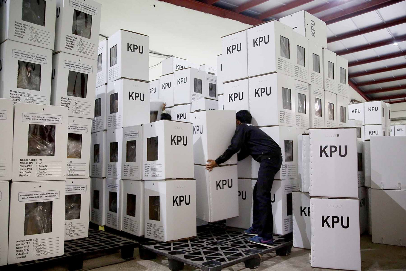 Workers from the Depok General Elections Commission (KPU) stack ballot boxes at a warehouse in Cimanggis district, Depok, West Java, on Nov. 25. The Depok KPU has started distributing supplies throughout the city in preparation for the 2020 regional elections on Dec 9. JP/P.J.Leo
