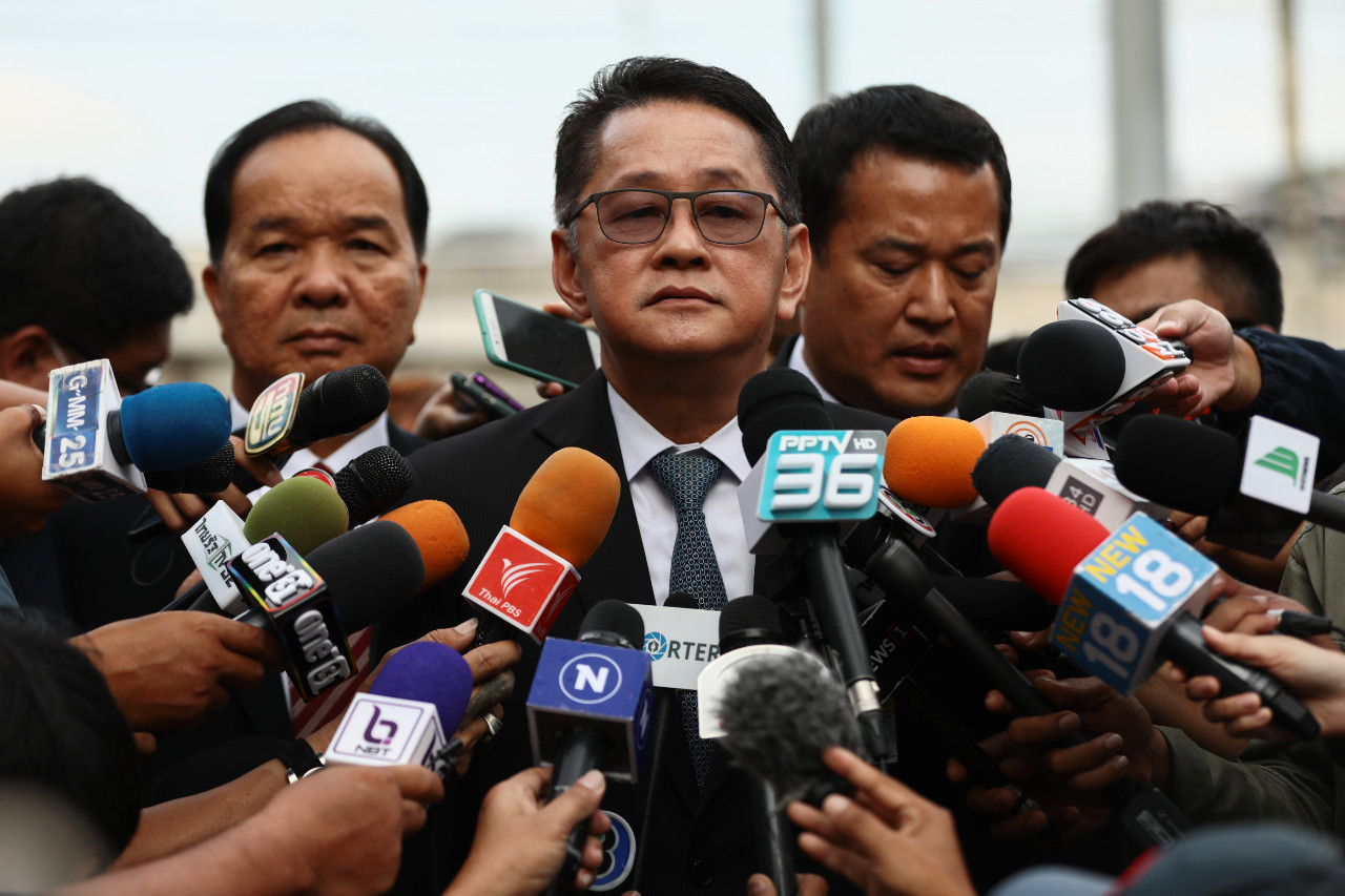 Thai PM wins crucial legal battle to stay in office