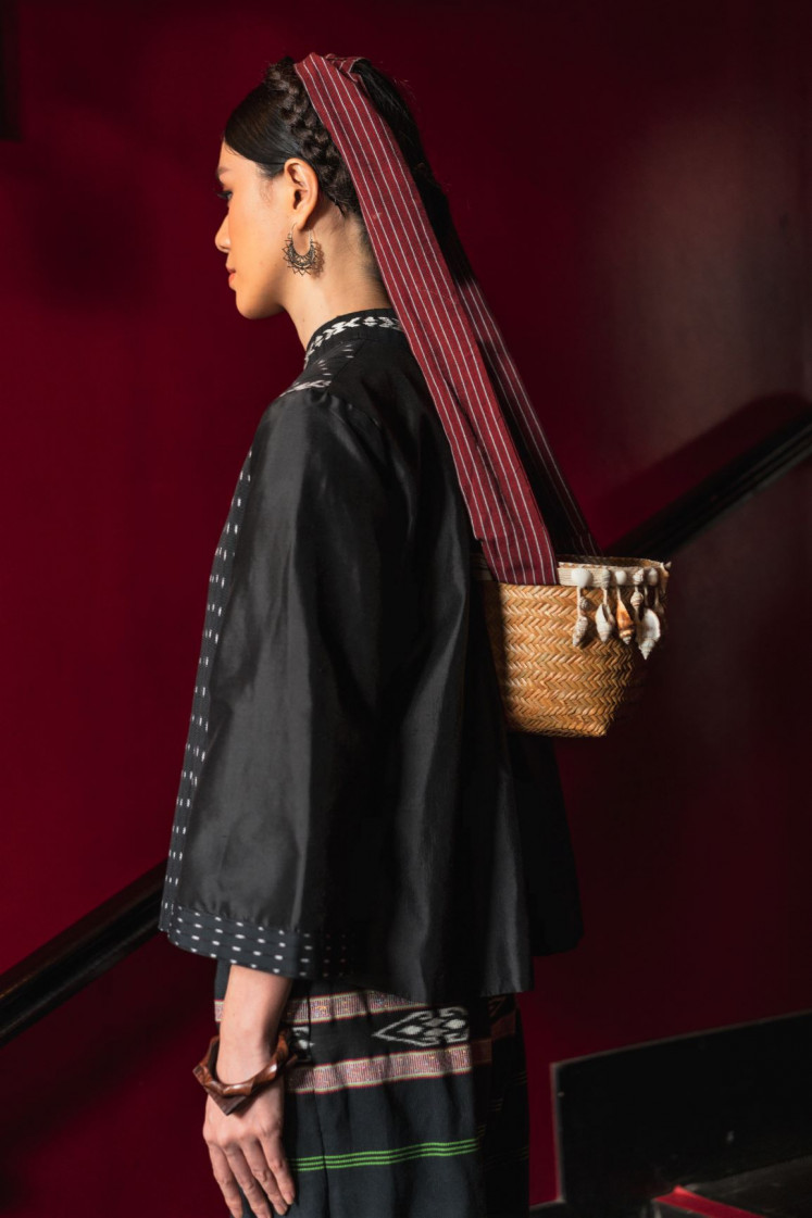 Weaving sustainability: The unique, indigenous culture of the Tanimbar people is preserved in the contemporary incarnation of couture brand IKAT Indonesia, including this woven pouch, which is traditionally draped around the head.