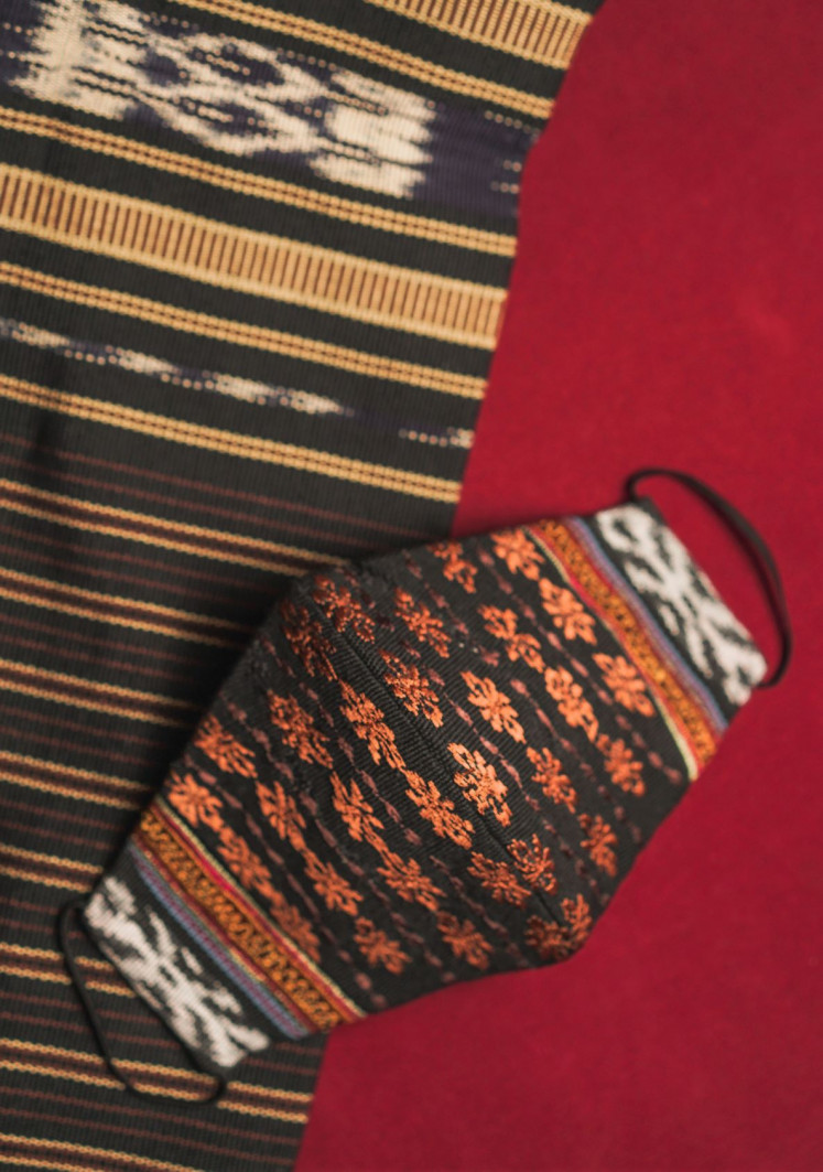 Masked messages: IKAT Indonesia's couture line, Svarna, features five mask variants made of Tanimbar ikat and named after Maluku surnames, such as the Gelfara mask with bronze embroidery.