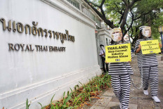 PETA activists dressed as monkey inmates protest outside the Royal Thai Embassy in Jakarta on Dec. 8. The protesters called on Thailand to end the use of monkey labor in the country's coconut industry. Monkeys, typically fitted with metal collars and chained for life, are often used to harvest coconuts at plantations. JP/Seto Wardhana