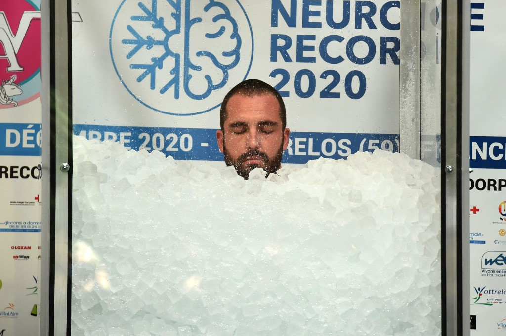 French 'Ice man' sets new world record in freezing glass cabin
