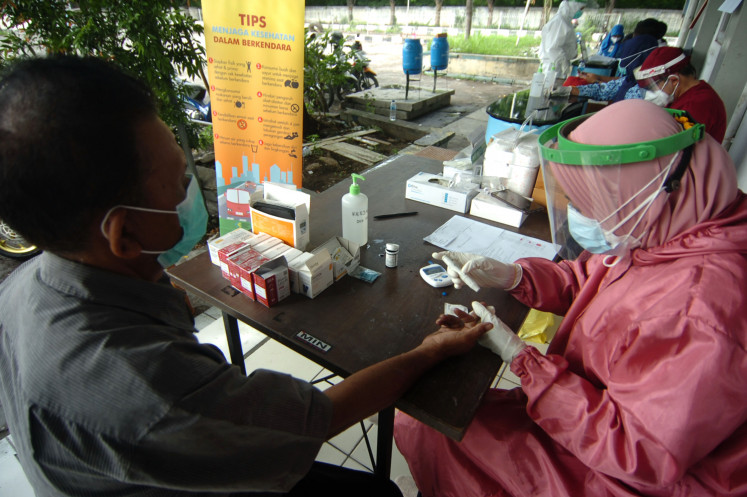 Central Java rations processing of swab samples due to labs' limited capacity