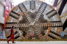 A worker inspects a tunnel-boring machine inside Tunnel 1 of the Jakarta-Bandung high speed railway project in Pondok Gede, Bekasi, West Java on Dec. 15. The machine has completed the 1.8-kilometer tunnel located under the Jakarta-Cikampek toll road. JP/Wendra Ajistyatama