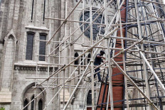 A worker assembles a giant Christmas tree in front of the St. Mary of Assumption Cathedral in Central Jakarta on Dec. 15. The giant tree was erected as part of the 2020 Christmas celebrations. JP/Seto Wardhana