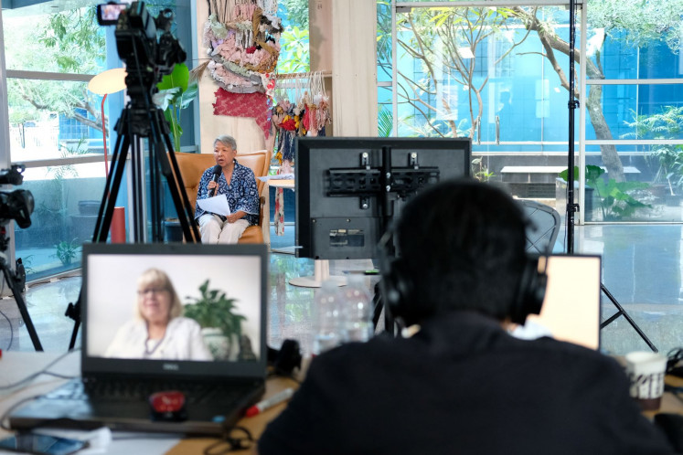 Through foreign lens: Australian author Jennifer Mackenzie (pictured on computer) is seen in one of the discussions at the Lontar Literary Festival 2020 in November.