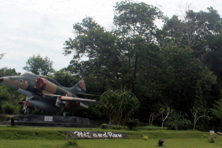 An example of an A-4E Skyhawk from the 12th Squadron now stands as a monument at its former home base, Roesmin Nurjadin Air Force Base in Pekanbaru.