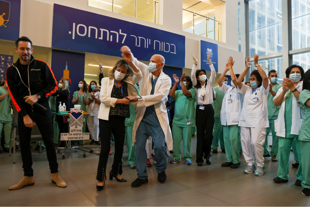 Israel starts reopening as number of COVID vaccinees nears 50 percent