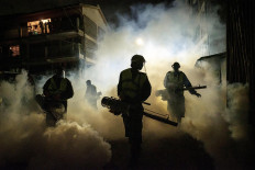 "Volunteers from Sonko Rescue Team, an NGO privately funded by Nairobi Governor Mike Sonko, fumigate a street to curb the spread of COVID-19 during a joint operation with Nairobi county during a 7pm-5am curfew at a residential area in Nairobi, Kenya, on April 6, 2020. - Kenyan President Uhuru Kenyatta on April 6 imposed a three-week ban on movement in and out of four main coronavirus ""infected areas"", including the capital Nairobi, ahead of the usually busy Easter weekend. Kenya currently counts 158 cases and six deaths from the virus, most of them in the capital, with a few cases also along the coast. AFP/Yasuyoshi Chiba"