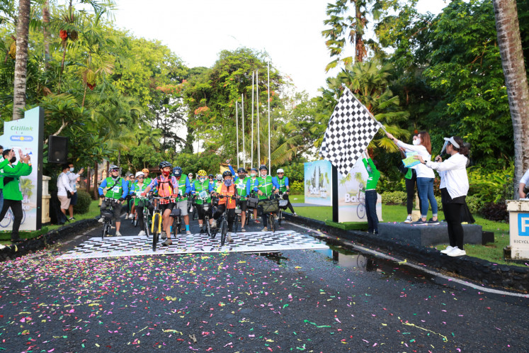 Refreshing finish: Participants cross the finish line of Bali Beach Bike, a cycling festival that covered 60 kilometers from Sanur to Ubud through the beautiful island landscape as a way to promote health, fitness and Bali tourism in wrapping up 2020.