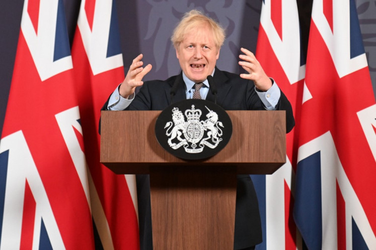 Britain's Prime Minister Boris Johnson gestures as he holds a remote press conference to update the nation on the post-Brexit trade agreement, inside 10 Downing Street in central London on December 24, 2020. Britain said on Thursday, December 24, 2020 an agreement had been secured on the country's future relationship with the European Union, after last-gasp talks just days before a cliff-edge deadline.