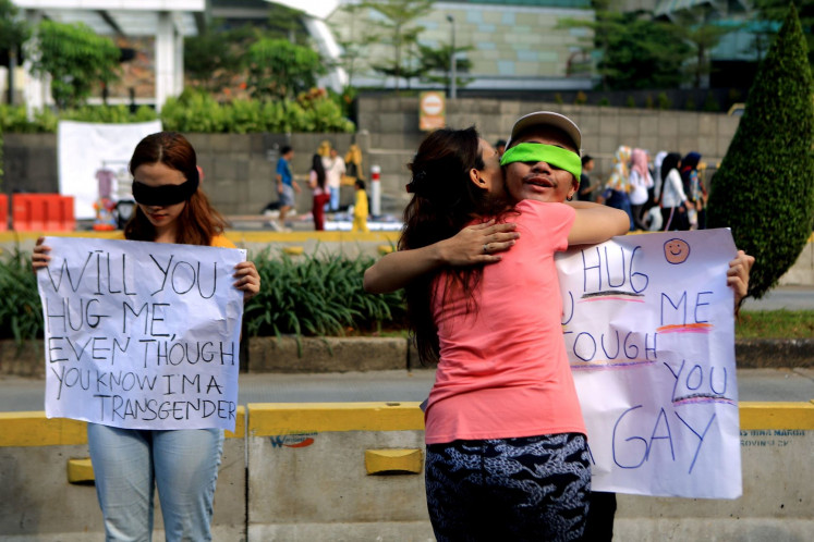 Hug please: A passerby hugs an activist campaigning for the rights of the lesbian, gay, bisexual and transgender (LGBT) community in Jakarta in June 2019.