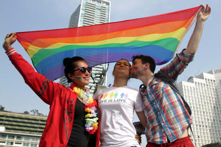 Love is love: Activists from Lesbian, Gay, Bisexual and Transgender (LGBT) communities stage a rally calling for greater protection of their rights in Jakarta in this file photo taken before the pandemic.