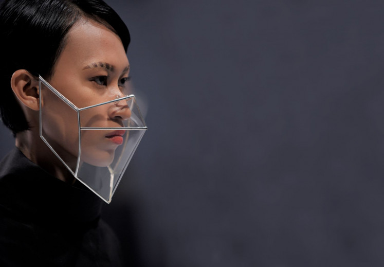 Into the future: A model sports a structured face shield made of crinoline and designed by renowned accessories designer Rinaldy A. Yunardi.