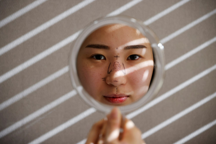 As end to pandemic mask-wearing nears, South Koreans scramble to arrange cosmetic surgery