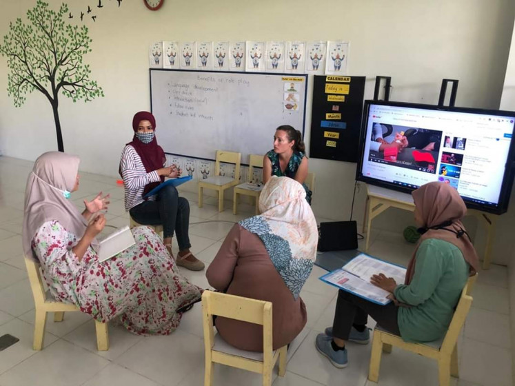 Briefed: Teachers prepare for distance learning at Sekolah Nusa Alam school in Lombok, West Nusa Tenggara in June last year.