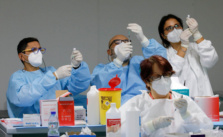 EU holds virus talks as Pfizer says vaccine 94% effective
