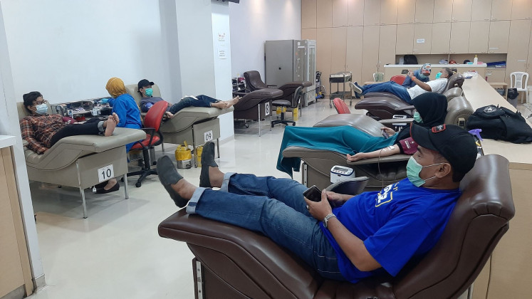 Caring: Donors have blood taken at the Indonesian Red Cross (PMI) in Jakarta.